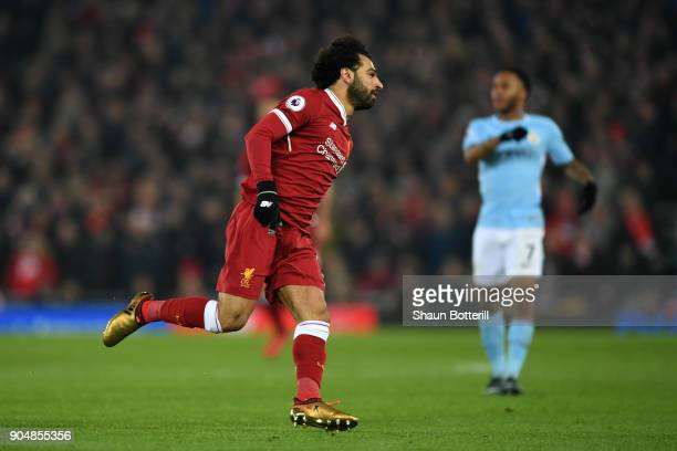 Mohamed Salah of Liverpool celebrates after scoring the fourth Liverpool goal during the Premier League match between Liverpool and Manchester City...