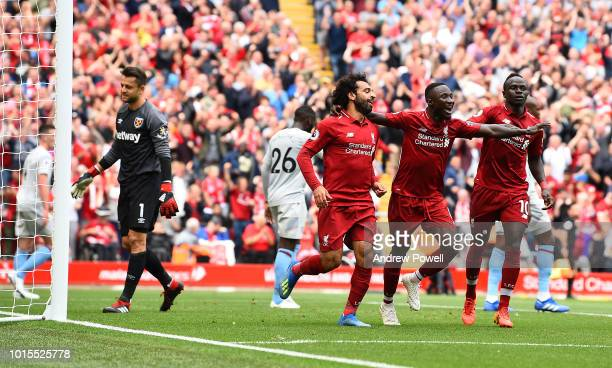 Mohamed Salah of Liverpool celebrates after scoring the opening goal during the Premier League match between Liverpool FC and West Ham United at...