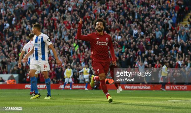 Mohamed Salah of Liverpool celebrates after scoring the opening goal during the Premier League match between Liverpool FC and Brighton Hove Albion at...