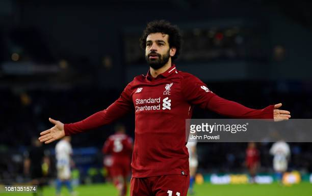 Mohamed Salah of Liverpool celebrates after scoring the opening goal during the Premier League match between Brighton Hove Albion and Liverpool FC at...
