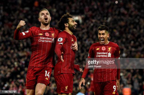 Mohamed Salah of Liverpool celebrates after scoring the opening goal during the Premier League match between Liverpool FC and Manchester City at...