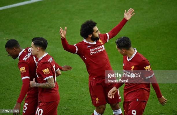 Mohamed Salah of Liverpool celebrates after scoring the opening goal during the Premier League match between Liverpool and Southampton at Anfield on...