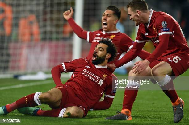 Mohamed Salah of Liverpool celebrates after scoring the opening goal during the UEFA Champions League Quarter Final Leg One match between Liverpool...