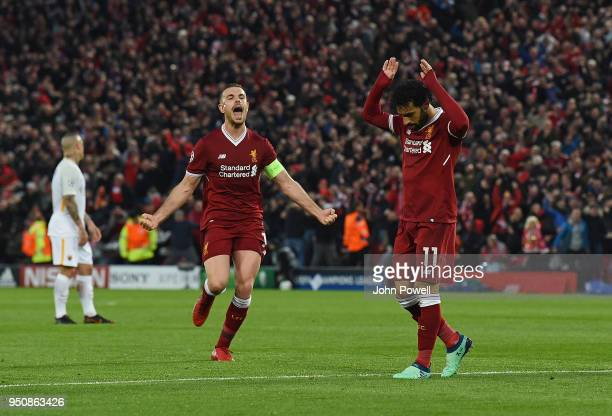 Mohamed Salah of Liverpool celebrates after scoring the opening goal during the UEFA Champions League Semi Final First Leg match between Liverpool...