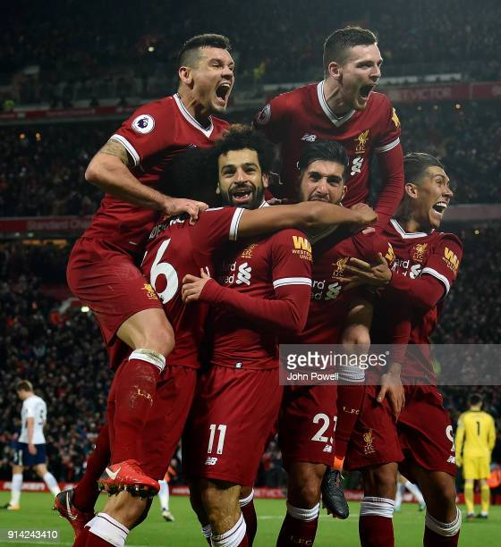 Mohamed Salah of Liverpool celebrates after scoring the second goal during the Premier League match between Liverpool and Tottenham Hotspur at...