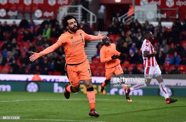 Mohamed Salah of Liverpool celebrates after scoring the third goal during the Premier League match between Stoke City and Liverpool at Bet365 Stadium...