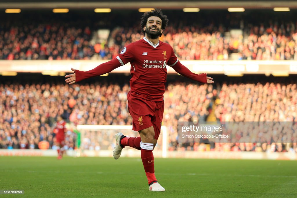 Mohamed Salah of Liverpool celebrates after scoring their 2nd goal during the Premier League match between Liverpool and West Ham United at Anfield on February 24, 2018 in Liverpool, England.