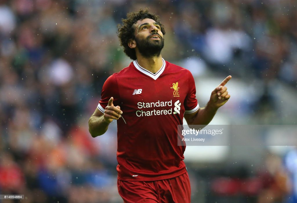 Mohamed Salah of Liverpool celebrates after scoring their first goal during the pre-season friendly match between Wigan Athletic and Liverpool at DW Stadium on July 14, 2017 in Wigan, England.