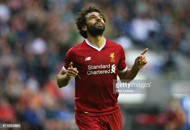 Mohamed Salah of Liverpool celebrates after scoring their first goal during the pre-season friendly match between Wigan Athletic and Liverpool at DW...