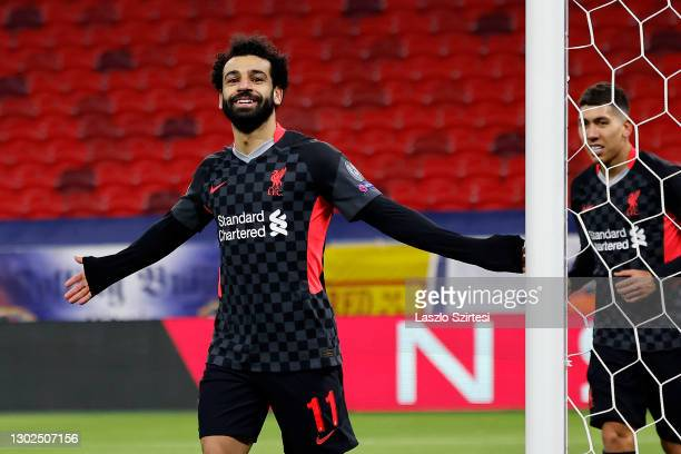 Mohamed Salah of Liverpool celebrates after scoring their side's first goal during the UEFA Champions League Round of 16 match between RB Leipzig and...