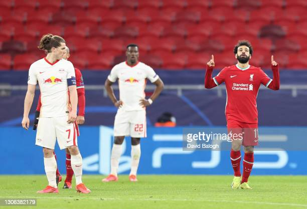 Mohamed Salah of Liverpool celebrates after scoring their side's first goal during the UEFA Champions League Round of 16 match between Liverpool FC...