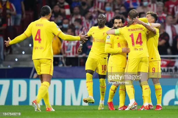 Mohamed Salah of Liverpool celebrates after scoring their side's first goal with Sadio Mane, Jordan Henderson and Roberto Firmino during the UEFA...