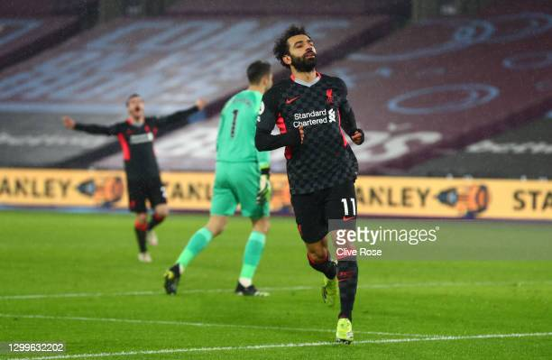 Mohamed Salah of Liverpool celebrates after scoring their side's second goal during the Premier League match between West Ham United and Liverpool at...