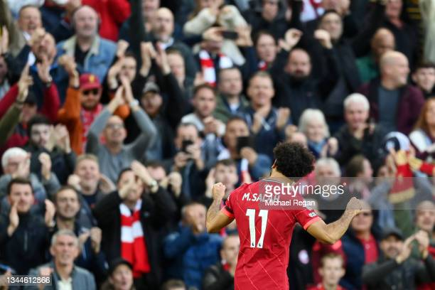Mohamed Salah of Liverpool celebrates after scoring their side's second goal during the Premier League match between Liverpool and Manchester City at...