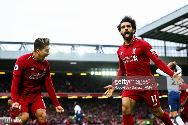 Mohamed Salah of Liverpool celebrates after Toby Alderweireld of Tottenham Hotspurscores an own goal to make it 2-1during the Premier League match...
