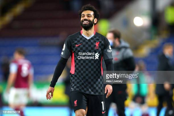 Mohamed Salah of Liverpool celebrates after victory in the Premier League match between Burnley and Liverpool at Turf Moor on May 19, 2021 in...