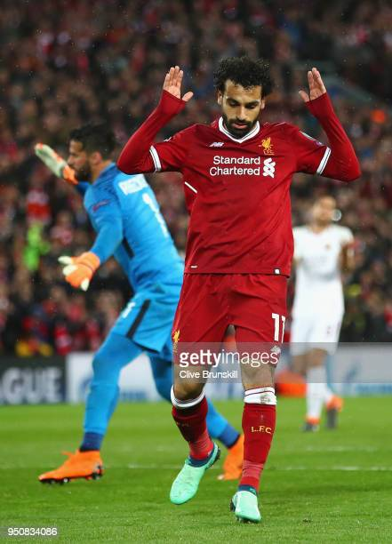 Mohamed Salah of Liverpool celebrates as he scores his sides second goal during the UEFA Champions League Semi Final First Leg match between...
