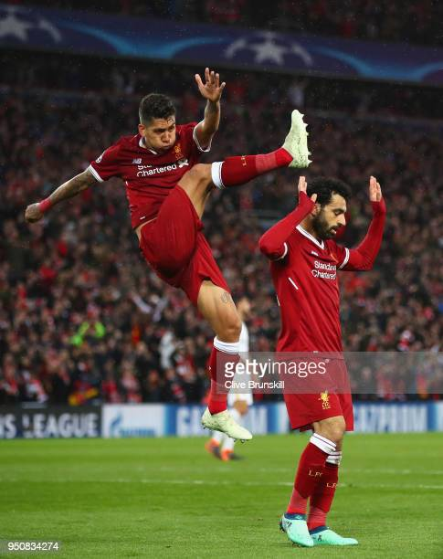 Mohamed Salah of Liverpool celebrates as he scores his sides second goal with Roberto Firmino during the UEFA Champions League Semi Final First Leg...