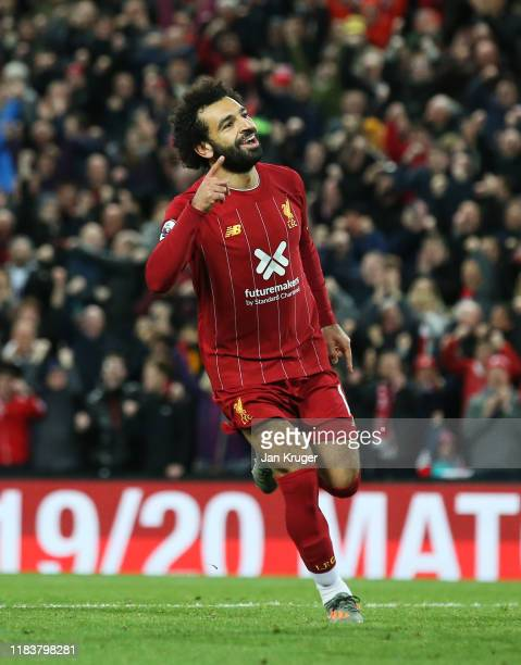 Mohamed Salah of Liverpool celebrates as he scores his team's second goal from a penalty during the Premier League match between Liverpool FC and...