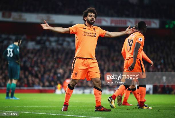 Mohamed Salah of Liverpool celebrates as he scores their second goal during the Premier League match between Arsenal and Liverpool at Emirates...