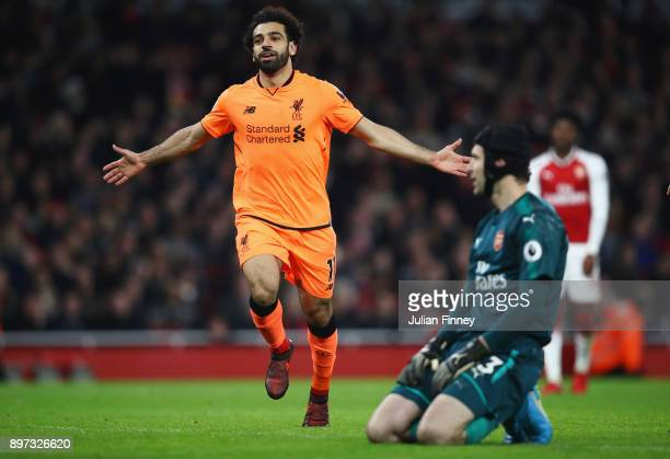 Mohamed Salah of Liverpool celebrates as he scores their second goal as Petr Cech of Arsenal looks dejected during the Premier League match between...