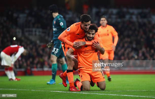 Mohamed Salah of Liverpool celebrates as he scores their second goal with Philippe Coutinho during the Premier League match between Arsenal and...