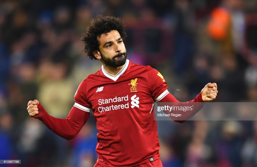 Mohamed Salah of Liverpool celebrates as he scores their third goal from the penalty spot during the Premier League match between Huddersfield Town and Liverpool at John Smith's Stadium on January 30, 2018 in Huddersfield, England.