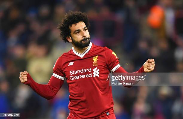 Mohamed Salah of Liverpool celebrates as he scores their third goal from the penalty spot during the Premier League match between Huddersfield Town...