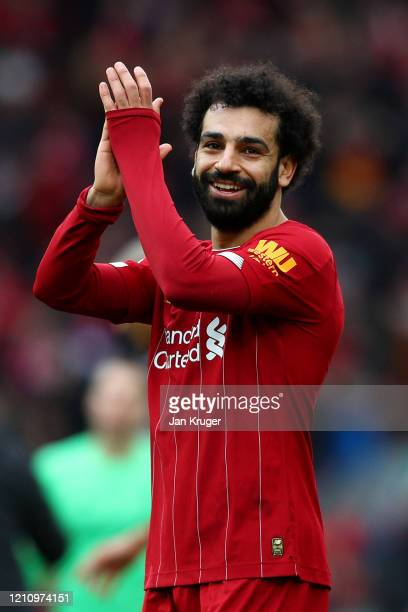 Mohamed Salah of Liverpool celebrates at the final whistle during the Premier League match between Liverpool FC and AFC Bournemouth at Anfield on...