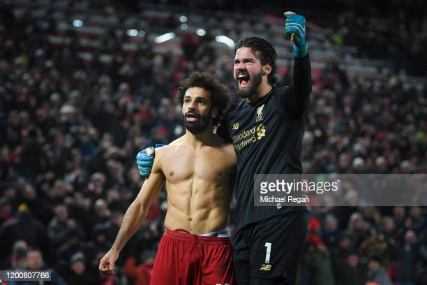 Mohamed Salah of Liverpool celebrates his goal to make it 20 with Alisson Becker during the Premier League match between Liverpool FC and Manchester...