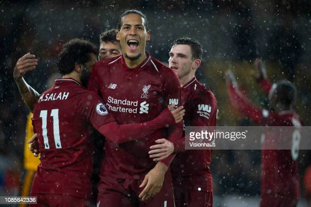 Mohamed Salah of Liverpool celebrates his goal with Virgil van Dijk during the Premier League match between Wolverhampton Wanderers and Liverpool FC...