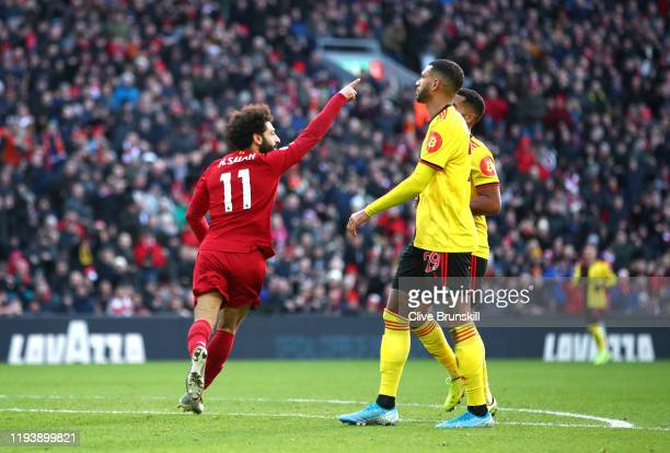 Mohamed Salah of Liverpool celebrates his sides first goal during the Premier League match between Liverpool FC and Watford FC at Anfield on December...
