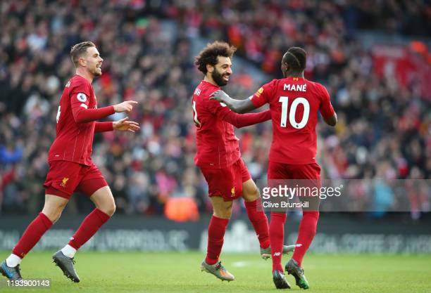 Mohamed Salah of Liverpool celebrates his sides first goal with Sadio Mane during the Premier League match between Liverpool FC and Watford FC at...