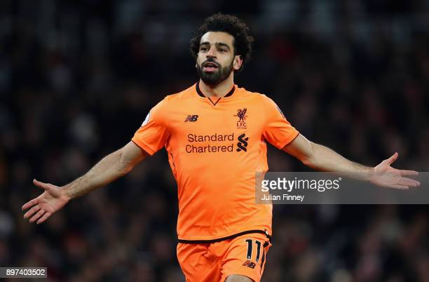 Mohamed Salah of Liverpool celebrates his teams second goal during the Premier League match between Arsenal and Liverpool at Emirates Stadium on...