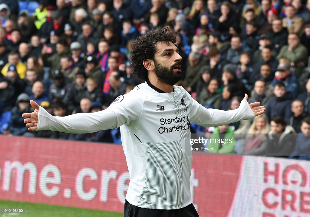Mohamed Salah of Liverpool celebrates his winner during the Premier League match between Crystal Palace and Liverpool at Selhurst Park on March 31, 2018 in London, England.