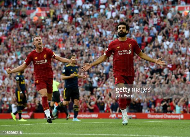 Mohamed Salah of Liverpool celebrates scoring from the penalkty spot during the Premier League match between Liverpool FC and Arsenal FC at Anfield...
