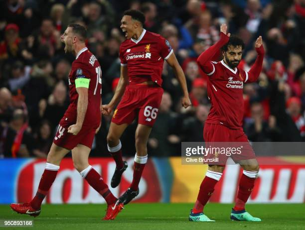 Mohamed Salah of Liverpool celebrates scoring his first goal with teammates Jordan Henderson and Trent AlexanderArnold during the UEFA Champions...