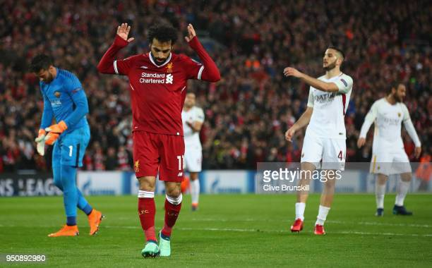 Mohamed Salah of Liverpool celebrates scoring his second goal during the UEFA Champions League Semi Final First Leg match between Liverpool and AS...