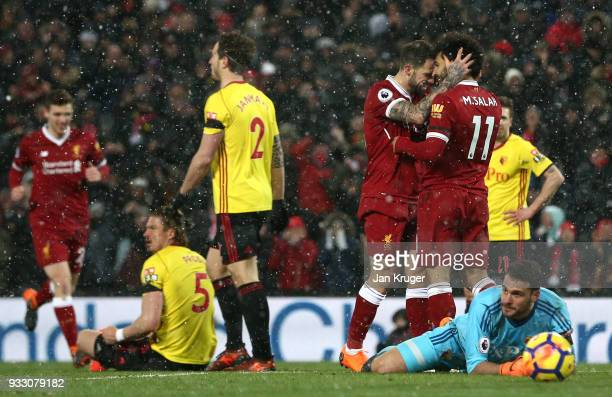 Mohamed Salah of Liverpool celebrates scoring his side's fifth goal with Danny Ings during the Premier League match between Liverpool and Watford at...