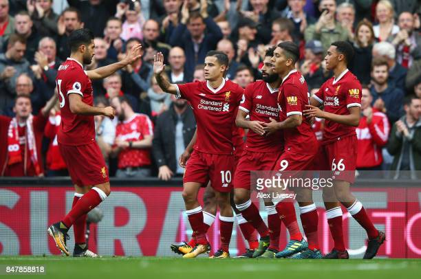 Mohamed Salah of Liverpool celebrates scoring his sides first goal with his Liverpool team mates during the Premier League match between Liverpool...