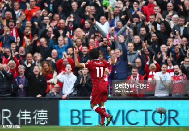 Mohamed Salah of Liverpool celebrates scoring his sides first goal during the Premier League match between Liverpool and Burnley at Anfield on...