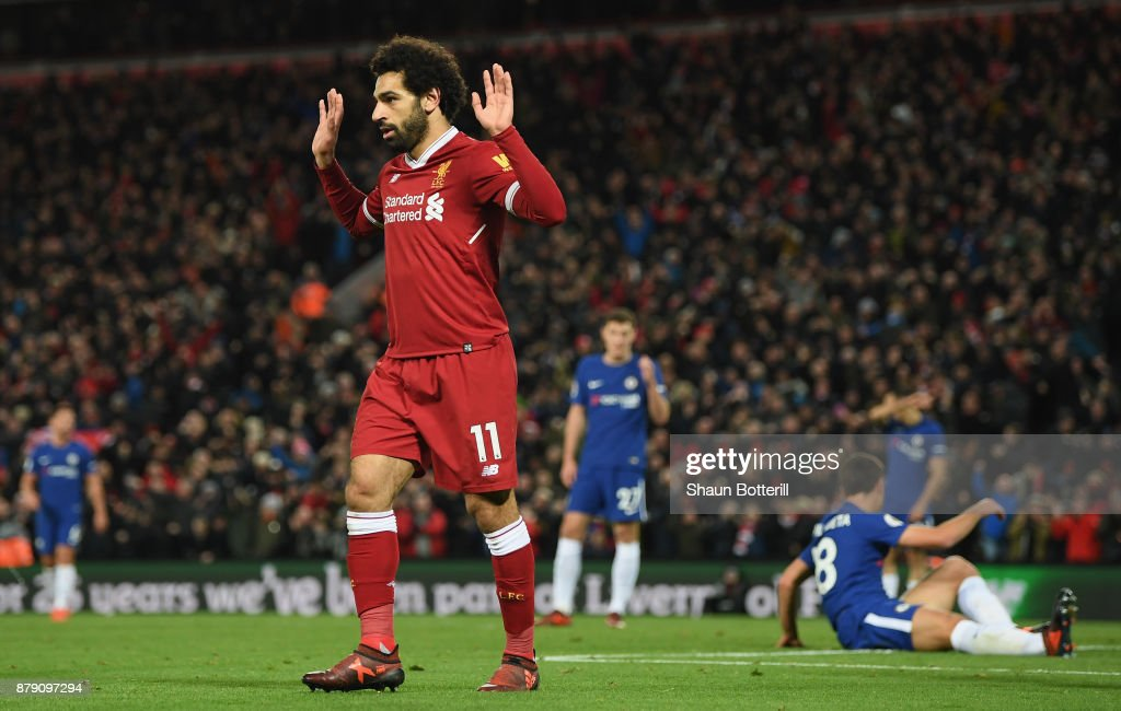 Mohamed Salah of Liverpool celebrates scoring his sides first goal during the Premier League match between Liverpool and Chelsea at Anfield on November 25, 2017 in Liverpool, England.