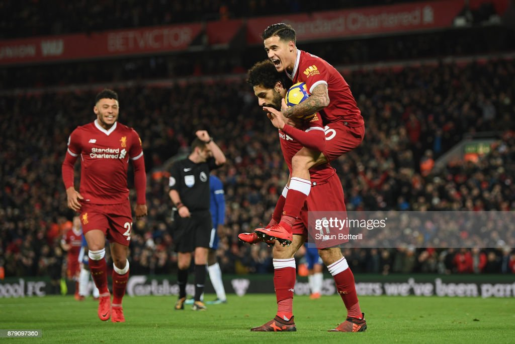 Mohamed Salah of Liverpool celebrates scoring his sides first goal with Philippe Coutinho of Liverpool during the Premier League match between Liverpool and Chelsea at Anfield on November 25, 2017 in Liverpool, England.