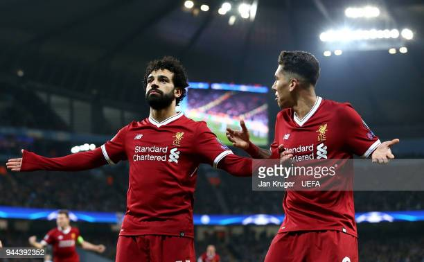 Mohamed Salah of Liverpool celebrates scoring his sides first goal during the UEFA Champions League quarter final second leg match between Manchester...