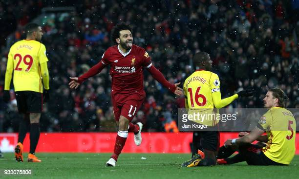 Mohamed Salah of Liverpool celebrates scoring his side's fourth goal during the Premier League match between Liverpool and Watford at Anfield on...