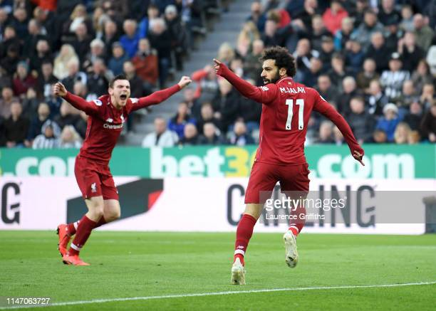Mohamed Salah of liverpool celebrates scoring his sides second goal with Andy Robertson during the Premier League match between Newcastle United and...