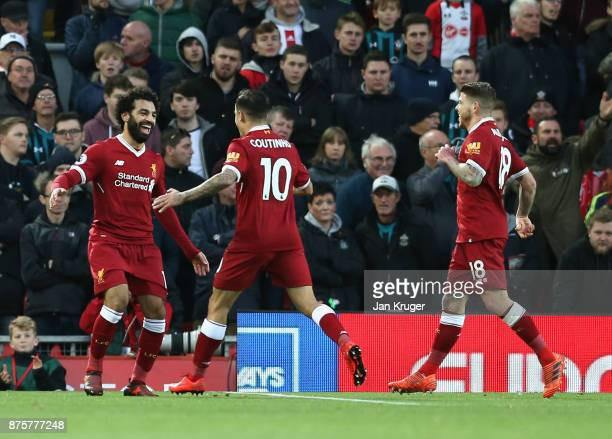 Mohamed Salah of Liverpool celebrates scoring his side's second goal with his team mates Philippe Coutinho and Alberto Moreno during the Premier...