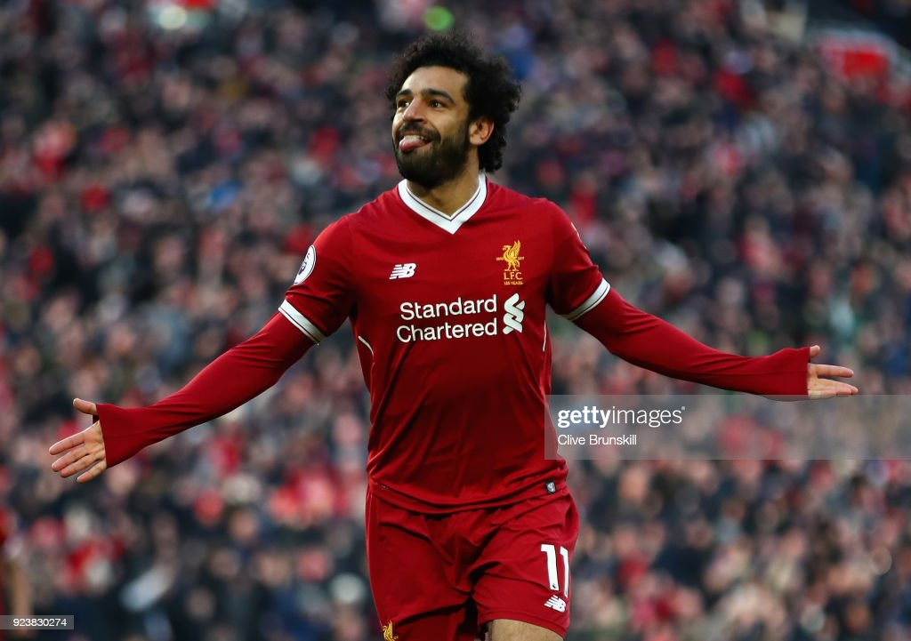 Mohamed Salah of Liverpool celebrates scoring his side's second goal during the Premier League match between Liverpool and West Ham United at Anfield on February 24, 2018 in Liverpool, England.