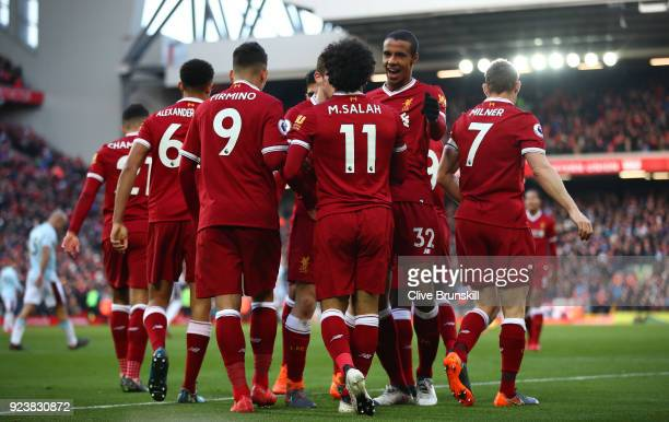 Mohamed Salah of Liverpool celebrates scoring his side's second goal with team mate Joel Matip during the Premier League match between Liverpool and...