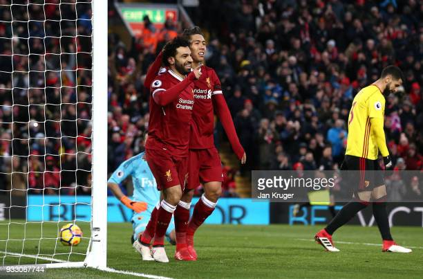 Mohamed Salah of Liverpool celebrates scoring his side's second goal with Roberto Firmino during the Premier League match between Liverpool and...